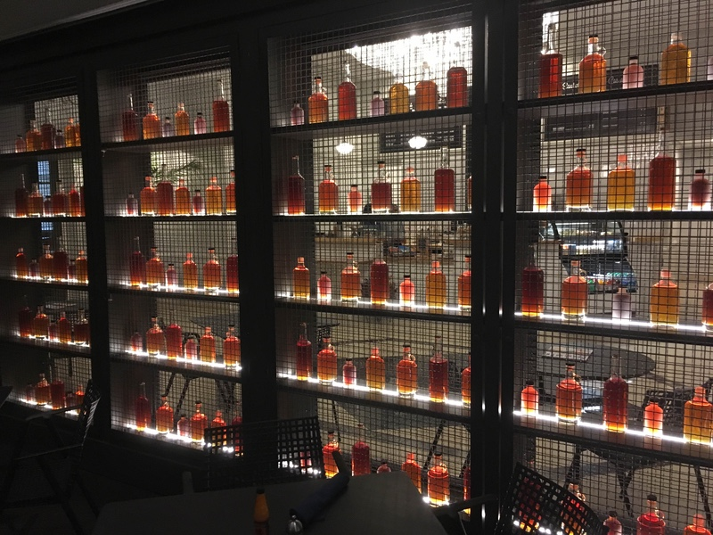 Edgar's Proof interior wall with bottles